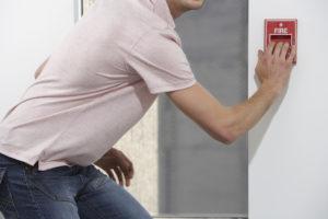 Man Pulling Fire Alarm